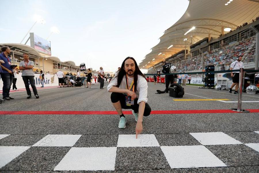 Formula One - F1 - Bahrain Grand Prix - Sakhir, Bahrain - 16/04/17 - American DJ Steve Aoki poses for photographers at the starting line during grid formation at the Bahrain F1 Grand Prix. REUTERS/Hamad I Mohammed - RTS12JXM